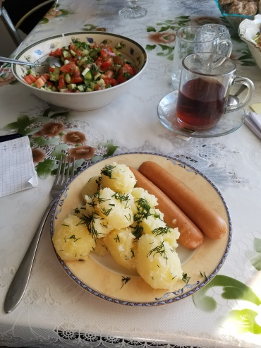 Ceai (Tea), potatoes and the cucumber and tomato salad that I will eat daily for next few weeks.