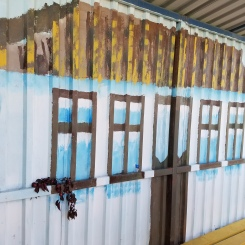 a mural in a rutiera stop shelter